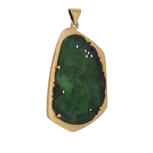 An early 20th century, yellow gold, flat, carved jade set pendant