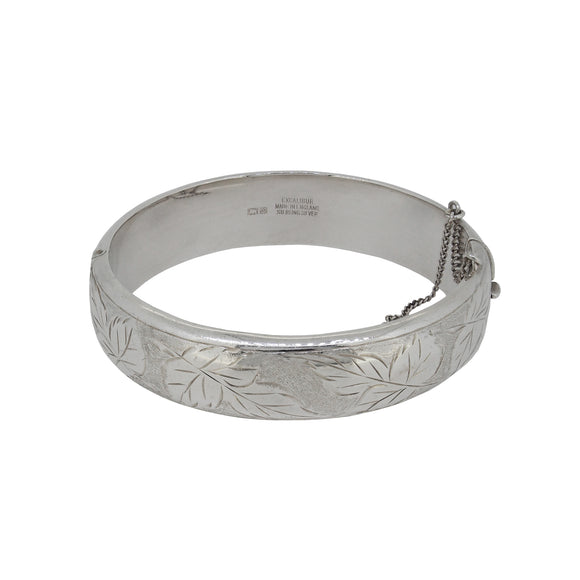 A mid 20th century, silver, half engraved, hinged bangle