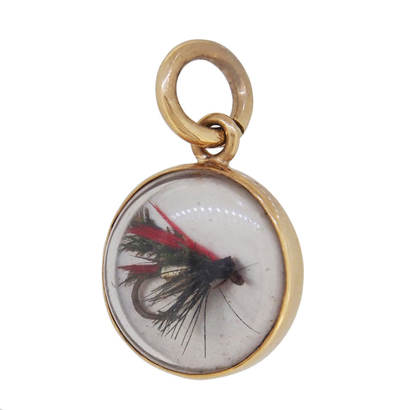 A modern, 9ct yellow gold, fly fishing pendant