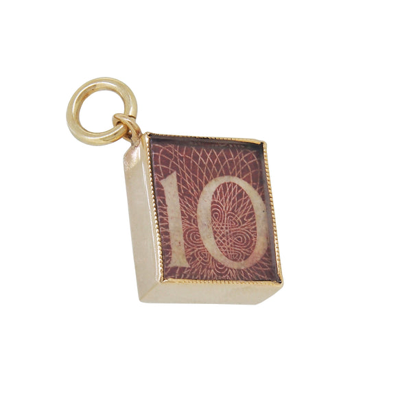 A mid 20th century, 9ct yellow gold, Ten Shilling note charm pendant