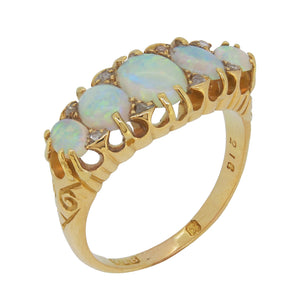 A Victorian, 18ct yellow gold, opal set half hoop ring