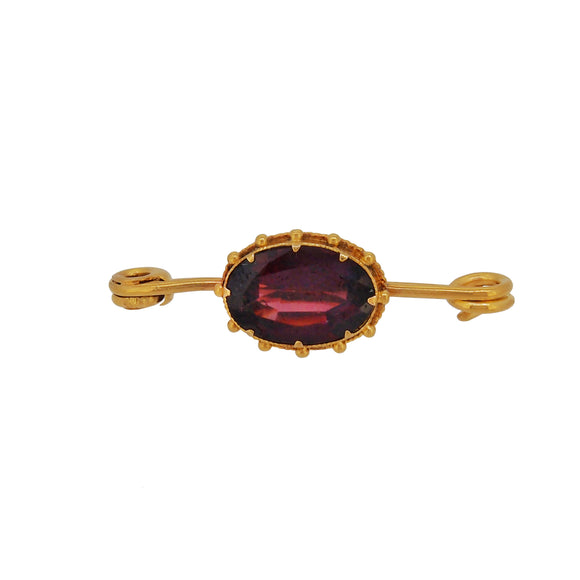 A Victorian, yellow gold, garnet set bar brooch