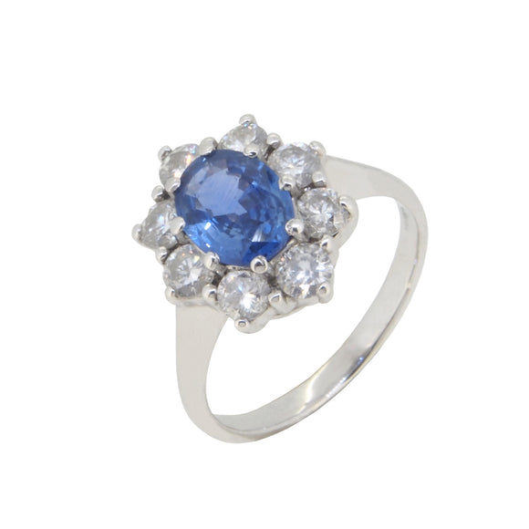 A modern, 18ct white gold, oval cut sapphire & diamond set cluster ring