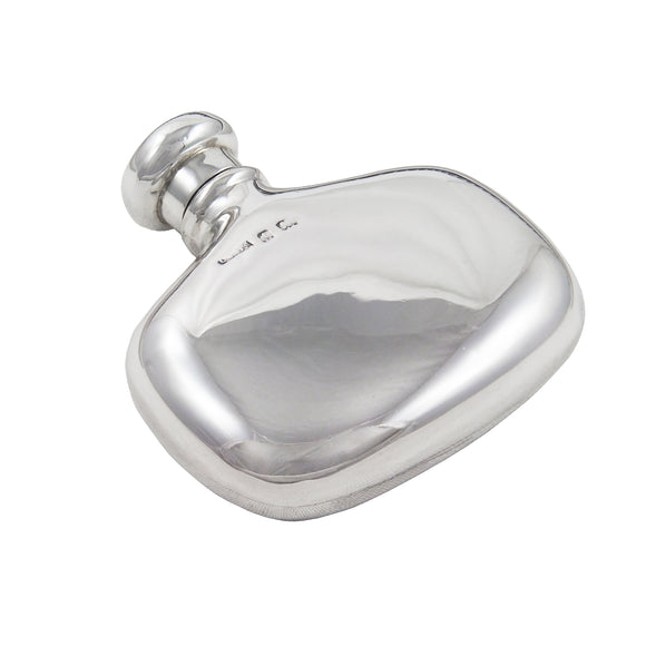 A silver spirit flask with a screw on lid
