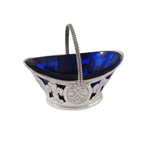 An Edwardian, silver, pierced sweet basket with a blue glass liner
