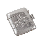 A modern, silver vesta case with an image of horses & riders on both sides