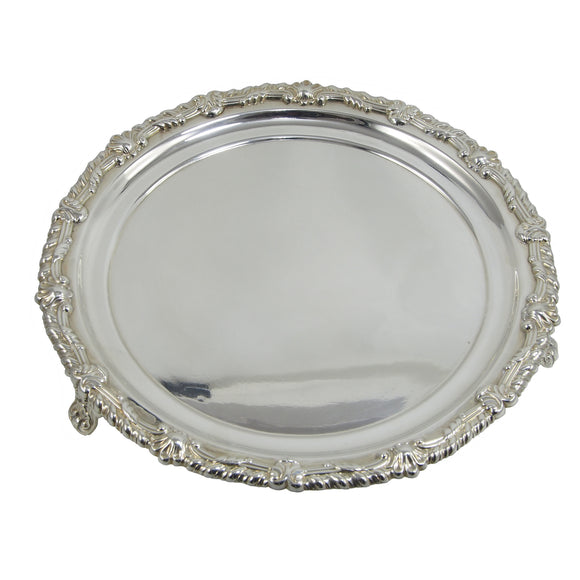 A Georgian, silver, circular salver on three feet