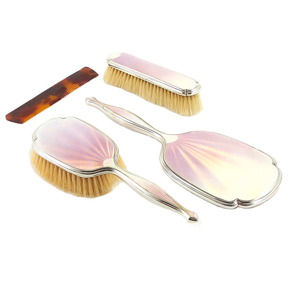 A mid 20th century, silver & pink enamel, four piece brush set