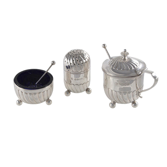 A Victorian, silver, three piece cruet
