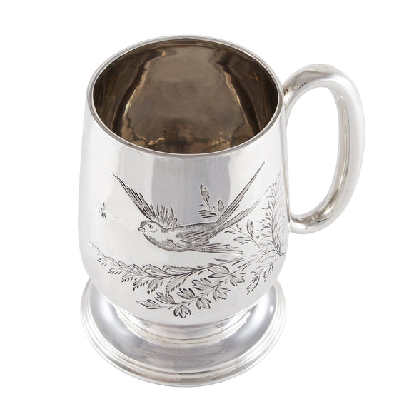 An Edwardian, silver, child's can engraved with the image of a swallow and leaves