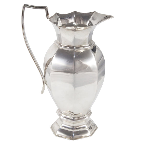 An Edwardian, silver, octagonal, paneled cream jug