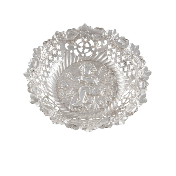 A Victorian, silver, pierced, circular bon bon dish with the image of a cherub in the bottom of the bowl