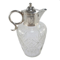 An Edwardian, cut glass, silver topped claret jug