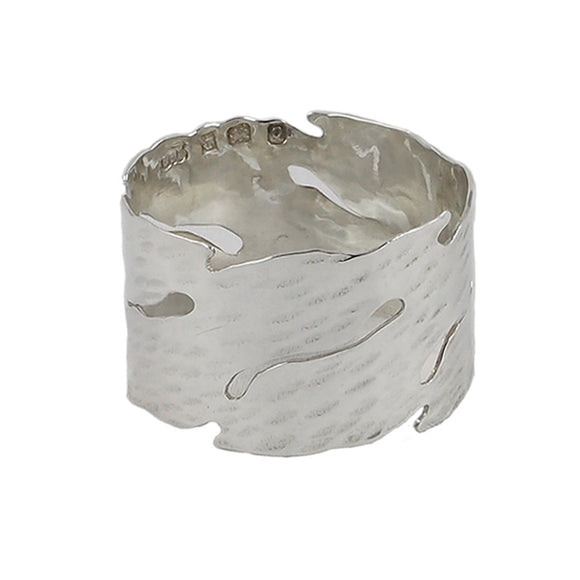 A modern, silver, wave napkin ring