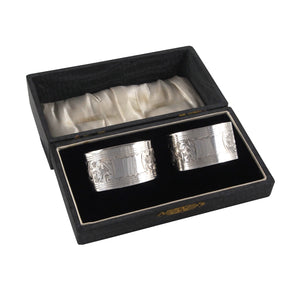 A pair of early 20th century, silver, engraved napkin rings & fitted case