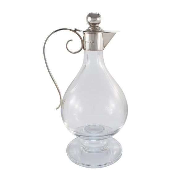 A Victorian, plain glass claret jug with a silver mount & handle