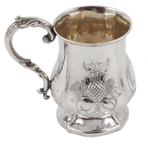 A Victorian, silver, child's can, embossed with the image of thistles