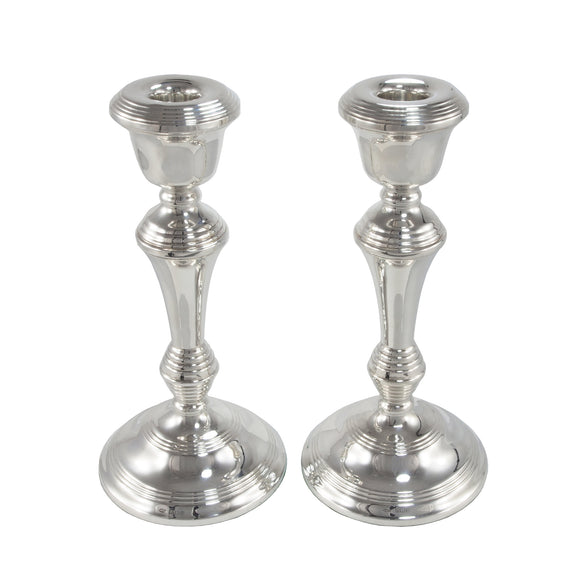 A pair of modern, silver candlesticks
