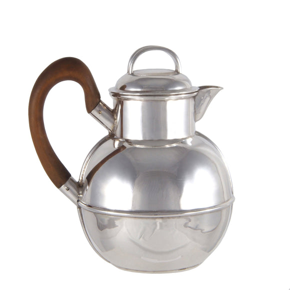 A Victorian, silver, Jersey jug with a wooden handle