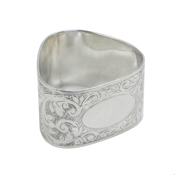 A mid 20th century, silver, triangular napkin ring
