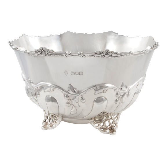 A Victorian, silver, circular, embossed bowl on four feet