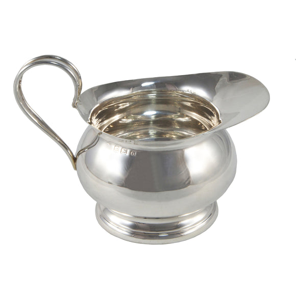 A mid 20th century, silver cream jug
