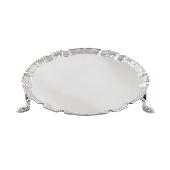 An early 20th century, silver, circular card tray on three feet