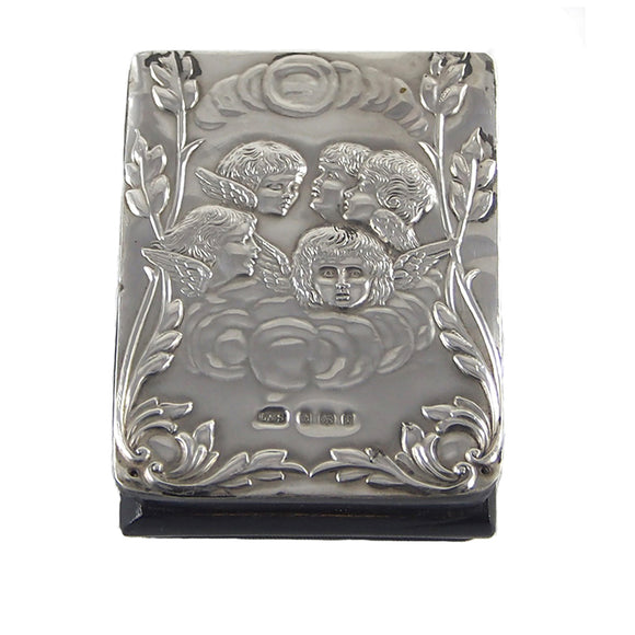 An Edwardian, silver fronted stamp case with an image of Cherubs on the front