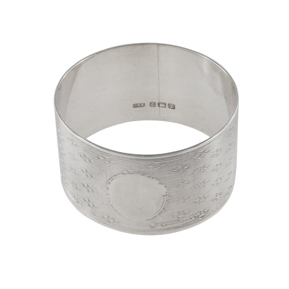 An early 20th century, silver, engine turned napkin ring