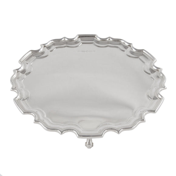 An Edwardian, silver, circular card tray on three feet