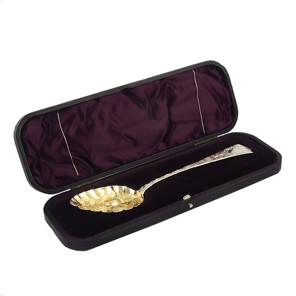 A Georgian, silver, fiddle pattern berry spoon & fitted case
