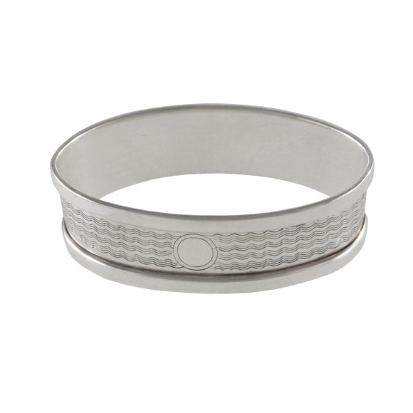 An early 20th century, silver napkin ring engraved with a wave pattern