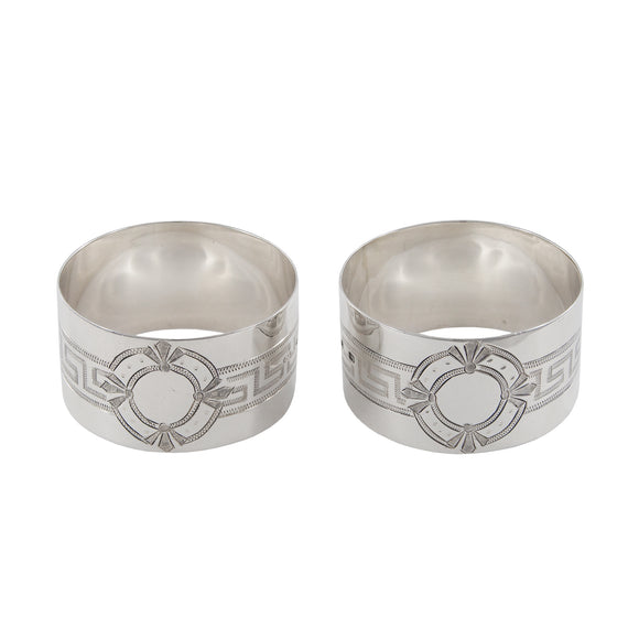 A pair of Victorian, silver, engraved napkin rings