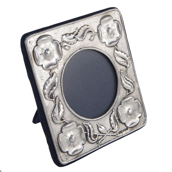 A modern, silver, square, floral photograph frame