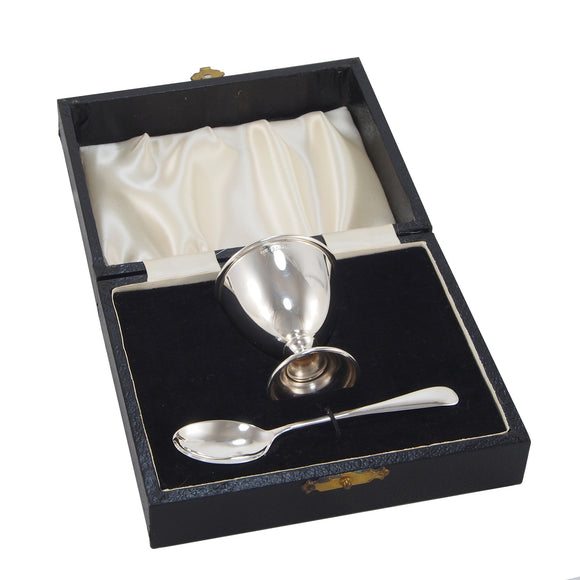 A modern, silver egg cup & spoon & fitted case