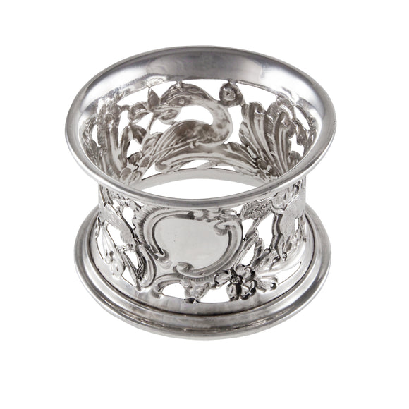 A Victorian, silver, pierced napkin ring with images of animals around the napkin ring