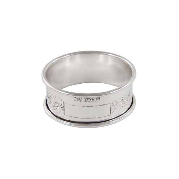 A modern, silver, engraved napkin ring
