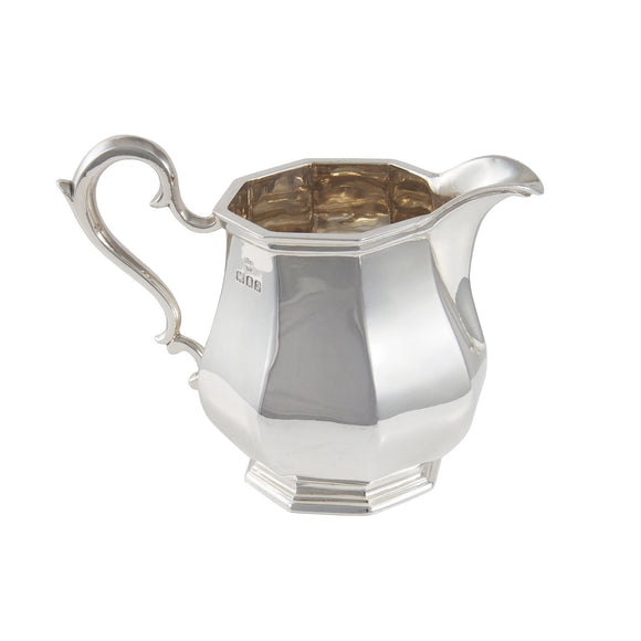 An early 20th century, silver, paneled, octagonal cream jug