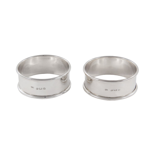 A pair of early 20th century, silver napkin rings