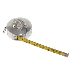 A silver tape measure with a flower on the top