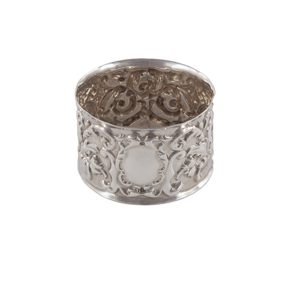 An Edwardian, silver, embossed napkin ring
