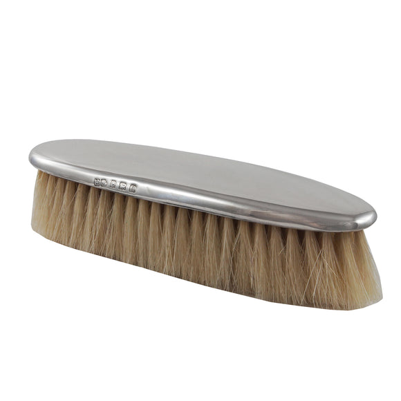 An Edwardian, silver backed, plain, clothes brush