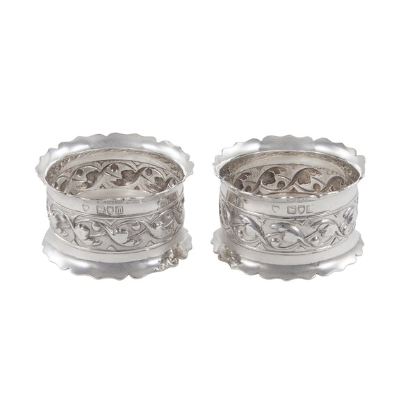 A pair of Edwardian, silver, embossed napkin rings