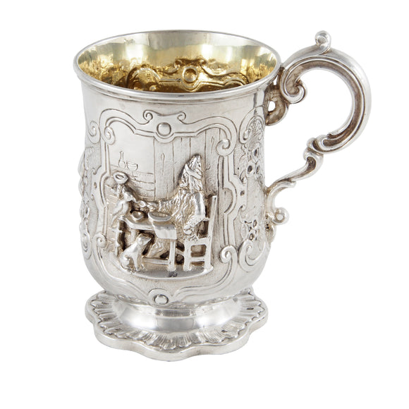 A Victorian, silver, child's tankard with a figure in relief of a person & fruit