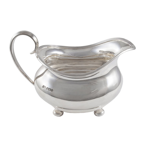 An early 20th century, silver cream jug