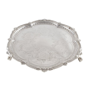 A Victorian, silver, engraved, circular salver on three feet