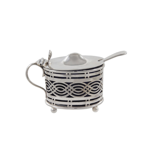 A Victorian, silver, pierced mustard pot with a blue glass liner & spoon