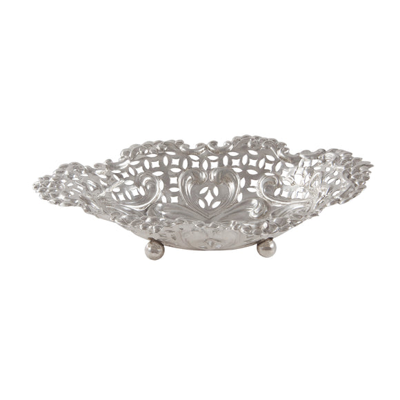 A Victorian, silver, oval, pierced bon bon dish on three ball feet