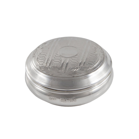A modern, silver, engine turned, lidded circular pill box
