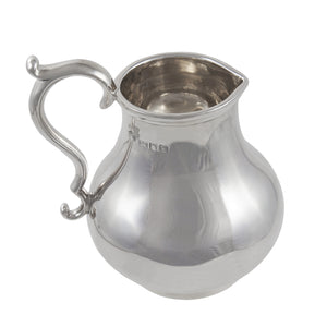 An Edwardian, silver cream jug